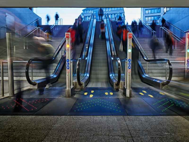 luminous escalator display in train station made of fiber optic cables
