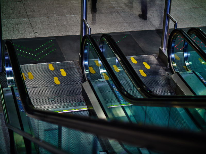 dynamic escalator display in train station made of fiber optic cables